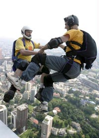 Gary Cunningham and Stephen Mueller doing a two way jump off KL Tower.